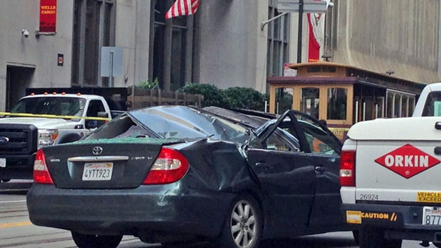 Window washer survives 11-story fall onto moving car in Calif.