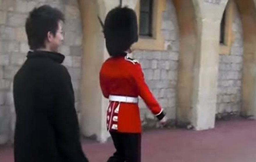 Queen's Guard Points Gun at Annoying Tourist