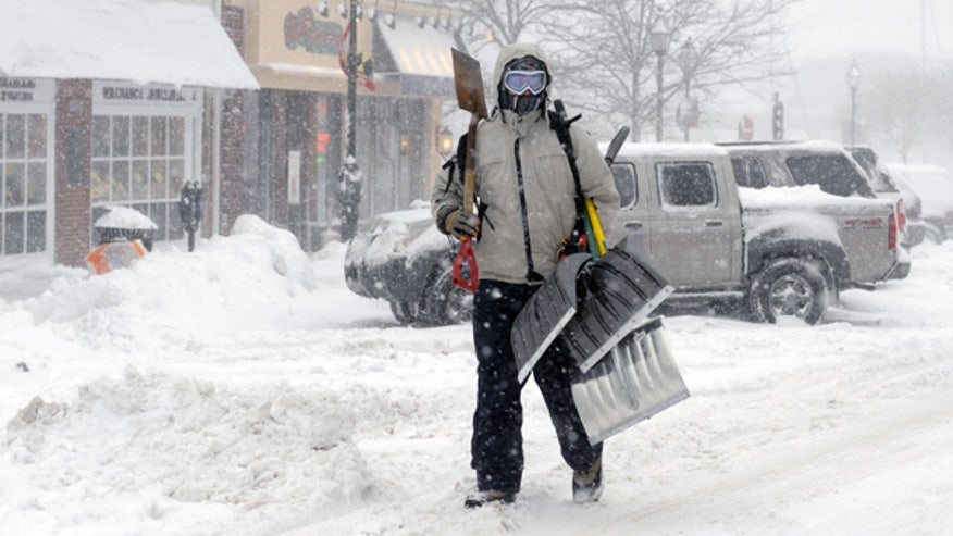 Man with snow shovels in Md.