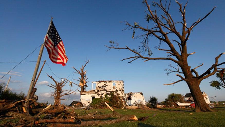 Flag flies at tornado-damaged house in Ohio