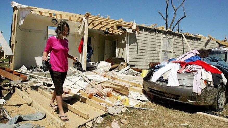 Woman in tornado destruction