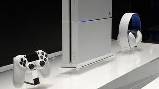 Microsoft Corp's Xbox Live was back up on Friday while Sony Corp's PlayStation Network remained offline for a second day after a hacker group claimed responsibility for attacking the two Internet gaming services.