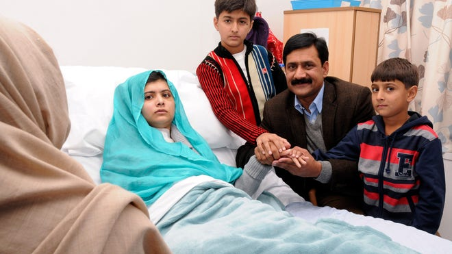 In this undated handout photo issued by Queen Elizabeth Hospital, in Birmingham, England, on Friday, Oct. 26, 2012, Malala Yousufzai in her hospital bed.
