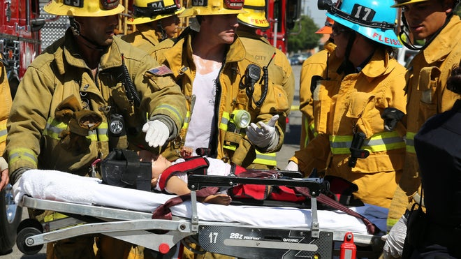 Aug. 29, 2012: Los Angeles City Firefighter paramedics assist a child, one of eight people injured when a car sped onto a sidewalk and plowed into a group of parents and children outside Main Street Elementary school in Los Angeles.  Read more: http://www.foxnews.com/us/2012/08/29/8-injured-after-car-slams-into-crowd-near-los-angeles-school/#ixzz24zhSRZfQ