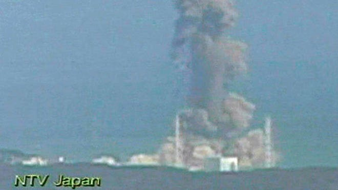 smoke ascends from the Fukushima Dai-ichi nuclear plant