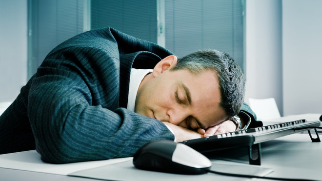 Businessman sleeping at desk
