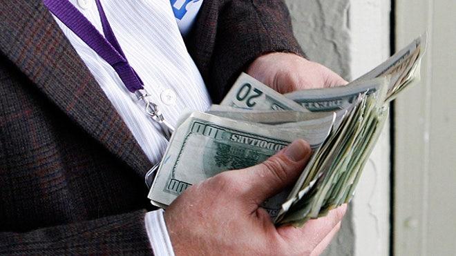 Man-Counting-Money-Cash-Dollars