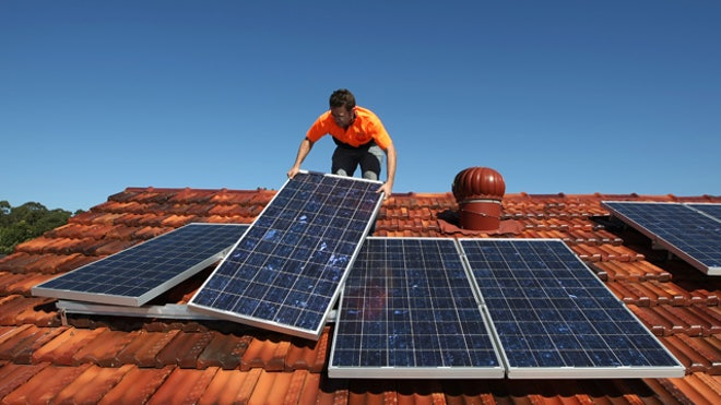 Man-Assembles-Solar-Panels-Roof-Home