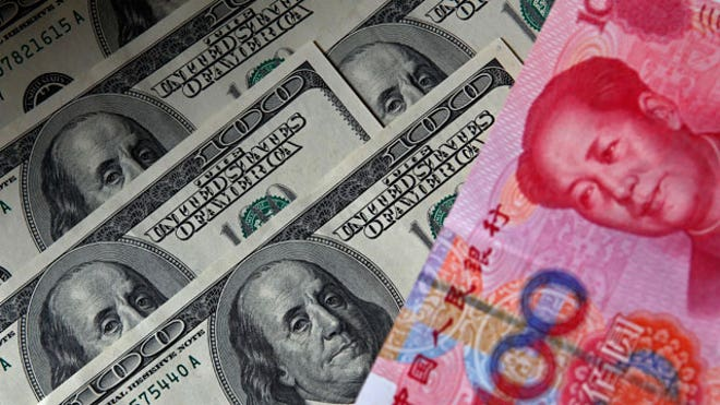 Yuan-Banknote-Next-to-US-Dollars