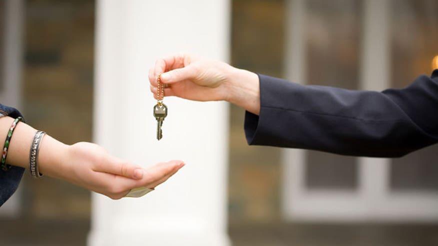 Keys-Handed-Off-Home-Auto-Sale