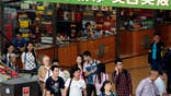 ZHUHAI, China/HONG KONG (Reuters) - In an underground mall just a stone's throw from China's teeming border with Macau, a row of  small shops with identical golden plaques does a brisk, though shadowy trade with mainland Chinese visitors, many of them bound for the gambling hub.