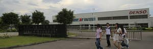 Two executives at auto parts maker Denso Corp  have agreed to plead guilty to conspiring to fix prices and have agreed to cooperate with an ongoing criminal investigation, the U.S. Justice Department said on Tuesday.