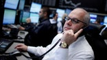 European shares ticked lower from multi-year highs Wednesday as shares of luxury goods stocks came under pressure.
