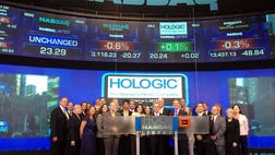 "Hologic Inc. marked the start of Breast Cancer Awareness Month at the NASDAQ's opening bell ceremony Monday. The traveling ""Tomo"" Coach offered close-up views of the state-of-the-art technology to those passing by in Times Square."