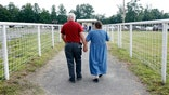 Retirement Couple Walking FBN