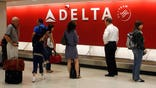 Delta Air Lines posted an operating loss in the first quarter but said it expects to make a profit next quarter despite higher fuel costs.