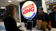 Investors seemed to welcome the announcement by Burger King late Sunday that it was in talks to buy Canadian coffee-and-doughnut chain Tim Hortons and create the world's third-largest fast-food restaurant company.