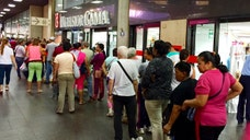 President Nicolás Maduro's response to shortages of products like toilet paper, articles for personal hygiene, diapers, milk and meat, has been to institute a system allowing citizens to shop only on certain days. It hasn't helped much, Venezuelans say, and it has created new problems.
