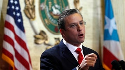 Puerto Rican Gov. Alejandro García Padilla said Wednesday that the cash-strapped U.S. commonwealth would default on $ million in bond payments due on Monday.