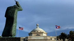Holders of bonds from Puerto Rico's Government Development Bank are suing to challenge aspects of a debt-moratorium law that island officials say is crucial to maintaining essential services as the U.S. territory struggles under a nearly $ billion debt load.