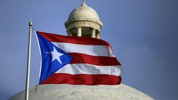 Hedge funds representing a group of Puerto Rico bondholders sued the U.S. territory on Wednesday, saying it violated the terms of a rescue package recently approved by Congress to help pull the island's government out of a dire economic crisis.