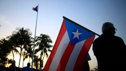 Puerto Rico's government is pushing a bond swap with creditors to help generate revenue as U.S. legislators prepare to consider creating an oversight authority to help pull the island out of a deepening economic crisis.