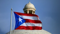 Puerto Rico's government is running out of money amid a decade-long economic crisis and now the bankrupt U.S. territory has agreed to a revenue cut - despite their desperate need for cash.