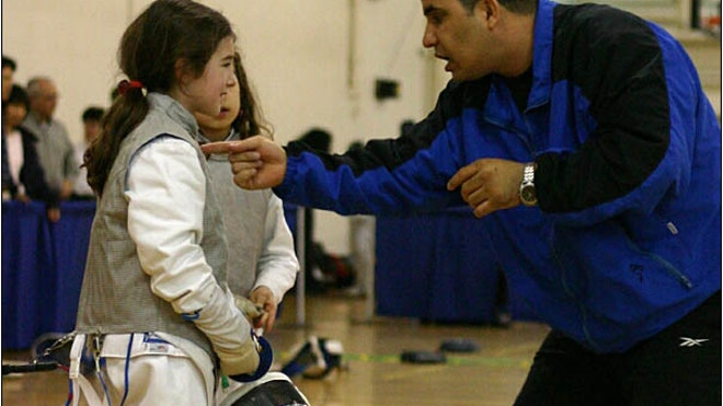 PHOTO_2_MORALES_COACHING_A STUDENT.jpg