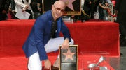 The rapper of Cuban descent Pitbull unveiled Friday his star on the Hollywood Walk of Fame at a ceremony in which he championed the culture and hard work of Latinos living in the U.S.