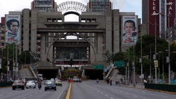The late president's face, his eyes, his name and even his signature are displayed on almost every public building in Caracas.
