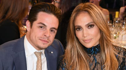 Jennifer Lopez and Casper Smart get the rumor mill rolling again after photographed kissing in Los Angeles.