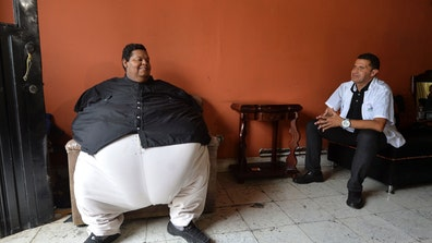 It takes a team of  men and a fire truck to get Oscar Vasquez Morales to the weight loss clinic where the fattest man in Colombia is receiving treatment that might save his life.
