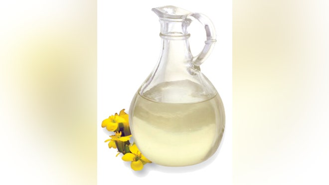 canola oil with the canola flowers.jpg
