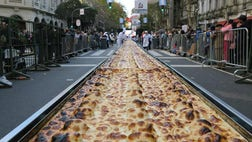 A pizzeria association in Buenos Aires cooked an -meter (-foot) empanada, the longest ever made in Argentina's capital city, for charity over the weekend.