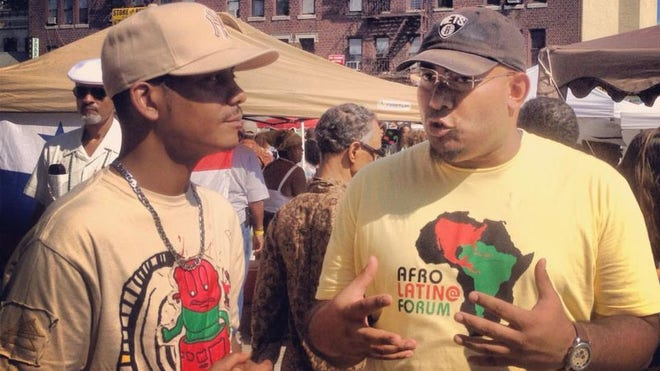 Afro Latino Forum Event 2 Men Talking.jpg