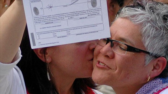 gay marriage mexico crop.jpg. A lesbian couple display their marriage ...