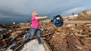 Oklahoma residents have returned to what remains of their homes after Monday's tornado killed at least  and destroyed countless homes while reducing one elementary school almost entirely to rubble, killing seven children.