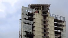 The skyscraper, long seen as a symbol of Venezuelan financial mismanagement and a symbol of the so-called property invasion under late leader Hugo Chávez, was built in  as a banking center but was abandoned and soon became home to the thousands of squatters.