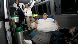 A Mexican man who weighs about , pounds ( kilos) and hadn't left his bed in six years has been removed by medical personnel for treatment.