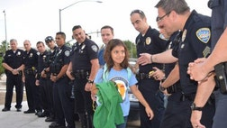 On Monday morning, Vanessa Vega returned to school – but she didn't arrive alone.More than a dozen Palm Springs police officers escorted the  year old on her first day back after her father was killed in the line of duty.