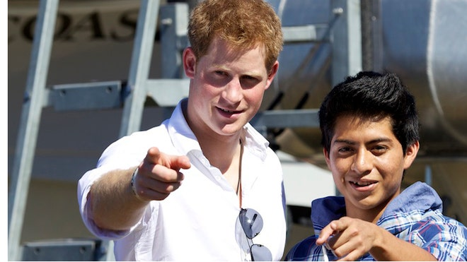 prince harry poses with local boy.jpg