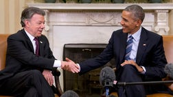 Nudging Colombia toward a peace deal that's finally within reach, President Barack Obama committed the United States on Thursday to helping the battle-scarred nation rebuild after half a century of guerrilla conflict.