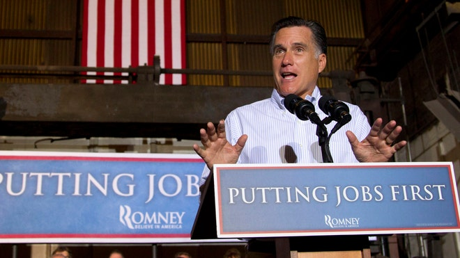 Republican presidential candidate, former Massachusetts Gov. Mitt Romney gestures during a campaign stop at Weatherly Casting Company in Weatherly, Pa., Saturday, June 16, 2012.