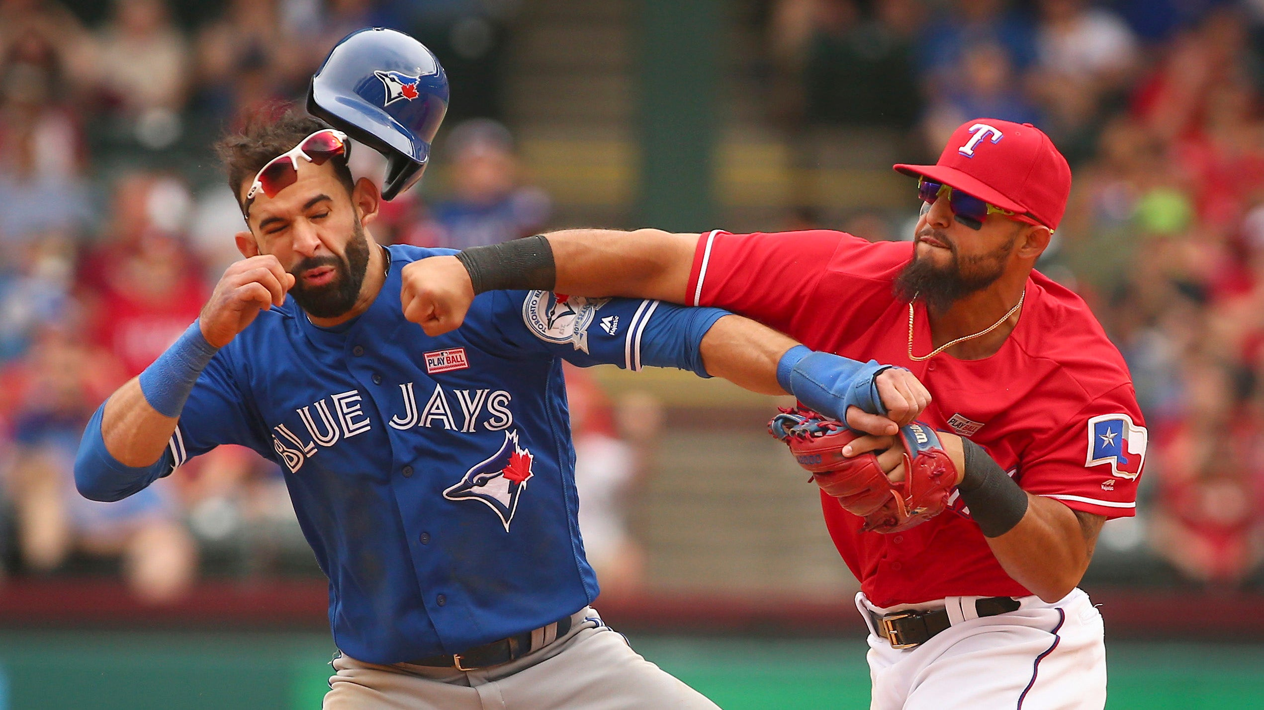 Blue Jays' Jose Bautista punched in the jaw when feud with Rangers erupts into brawl | Fox News Latino