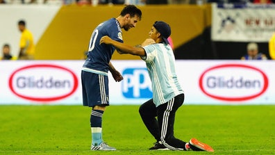 A fan ran into the pitch at the U.S. match against Argentina and got an autograph and two hugs from his hero, Leo Messi.