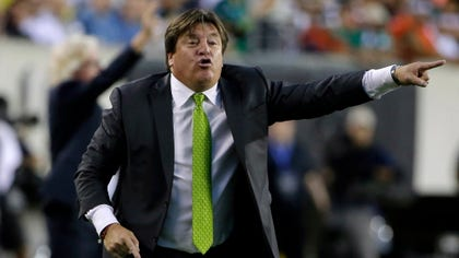 Miguel Herrera's off-field composure is being questioned after a television sports anchor claimed the coach punched him at the Philadelphia airport following Mexico's - victory over Jamaica to take the Gold Cup.