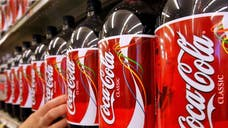 A British woman who consumed  liters of Coca-Cola a day lost almost half her body weight after giving up the drink, according to a report.