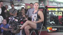 Ronda Rousey is preparing for her next fight in Australia jabbing to the rhythm of her hands-down favorite, salsa singer Hector Lavoe.