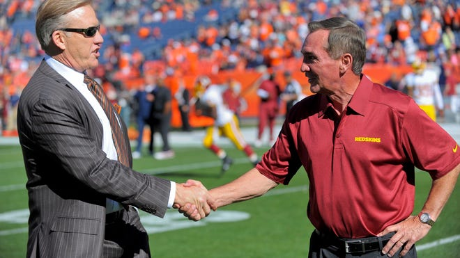 John Elway greets Mike Shanahan before Redskins vs. Broncos, 2013