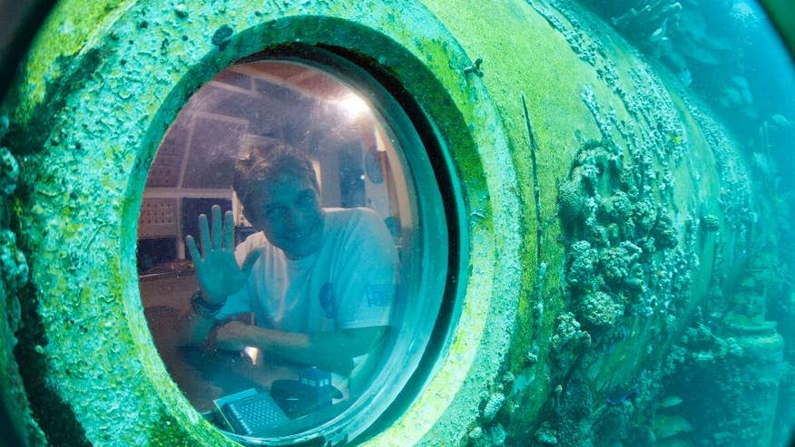 Cousteau lauds scientific research accomplished during 31-day underwater living experiment